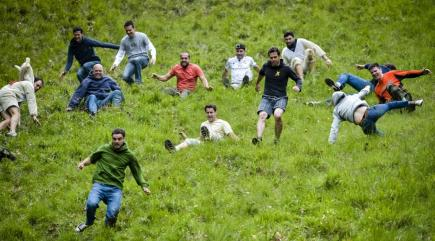 15 of the best pictures from the annual cheese rolling at Cooper's Hill