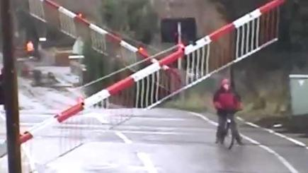 CCTV captures near miss as cyclist gets stuck on level crossing