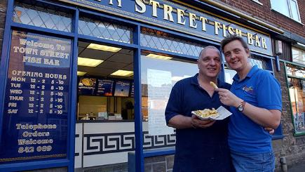 Duncan Hogg and wife Sarah in front of chip shop