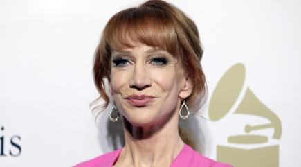 Kathy Griffin poses with bloodied, served Donald Trump head