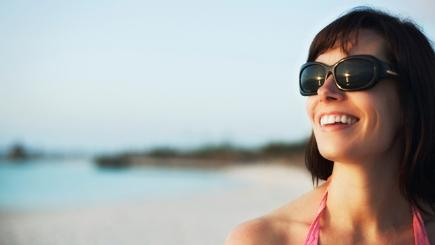 Woman wearing sunglasses on the beach