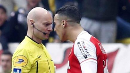 Nabil Dirar of Monaco sees red after a confrontation with the referee following a foul