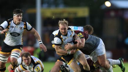 Wasps' Dan Robson is takled by Harlequins' Rob Buchanan.