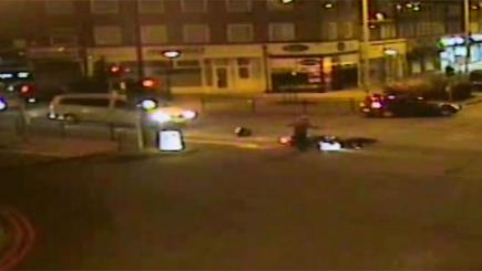 Biker stands over pedestrian he has just hit and knocked unconscious