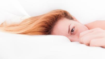 Woman laying awake in bed