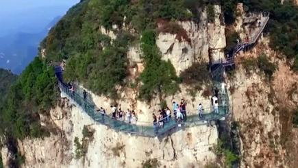 Tourists' terror as 3,500ft-high glass walkway shatters in China