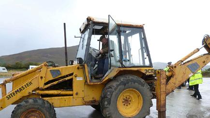 Jonathan Williams-Ellis in his mechanical digger.