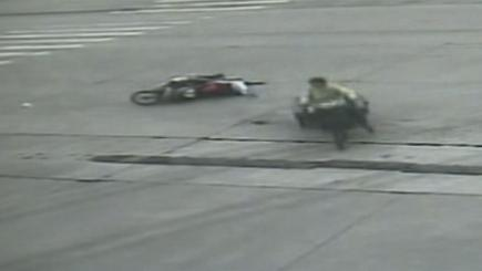 Screengrab of  footage of a child who somehow switched from the back of one motorbike to another when the two crashed.