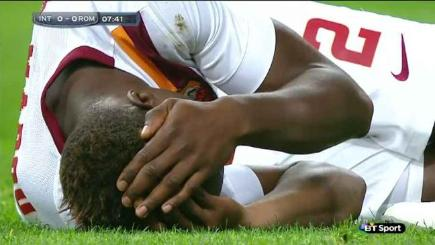 Mapou Yanga-Mbiwa of Roma after being accidentally kicked in the head by a team mate.